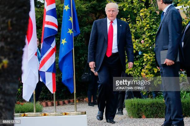 US President Donald Trump arrives for a family photo with leaders of the G7 and leaders of some African countries that have been invited for the...