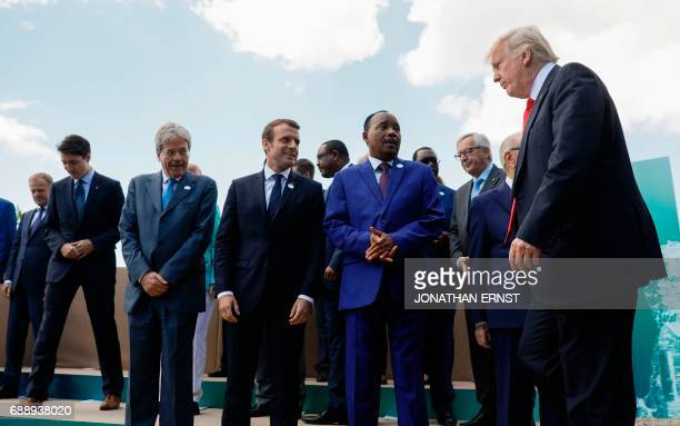 US President Donald Trump arrives for a family photo with President of the European Council Donald Tusk Canadian Prime Minister Justin Trudeau...