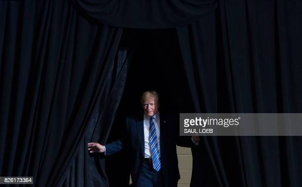 President Donald Trump arrives for a Make America Great Again Rally at Big Sandy Superstore Arena in Huntington West Virginia August 3 2017 / AFP...