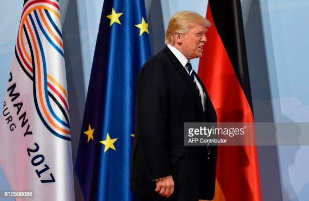 US President Donald Trump arrives for a 'retreat meeting' on the first day of the G20 summit in Hamburg northern Germany on July 7 2017 Leaders of...