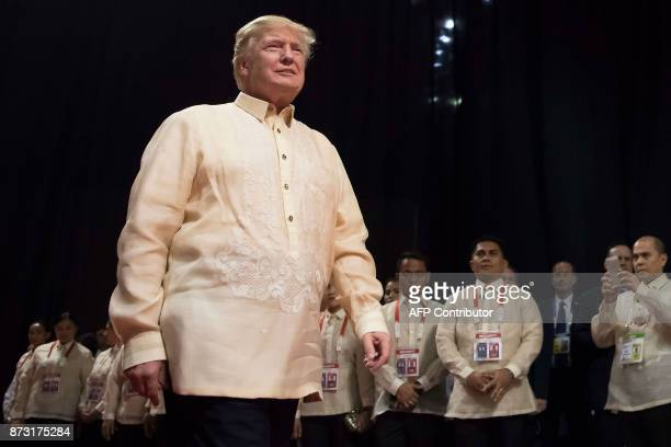 US President Donald Trump arrives for a special gala celebration dinner for the Association of Southeast Asian Nations in Manila on November 12 2017...