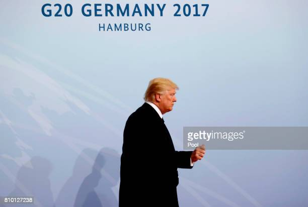 President Donald Trump arrives for the opening day of the G20 summit on July 7 2017 in Hamburg Germany Leaders of the G20 group of nations are...