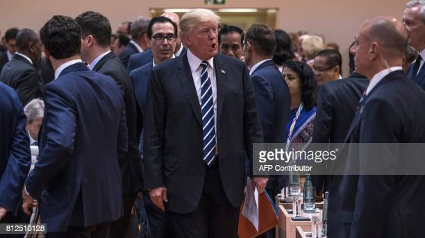 US President Donald Trump arrives for the start of the first working session of the G20 meeting in Hamburg northern Germany on July 7 2017 Leaders of...