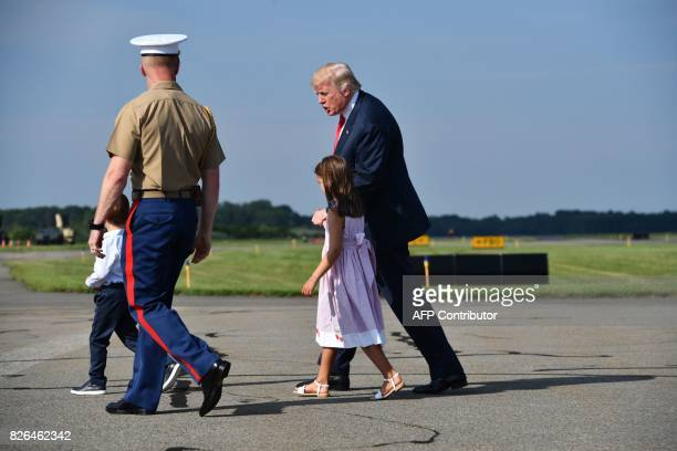 US President Donald Trump arrives in Morristown New Jersey on August 4 with grandchildren Arabella Kushner and Joseph Kushner Trump will spend a...