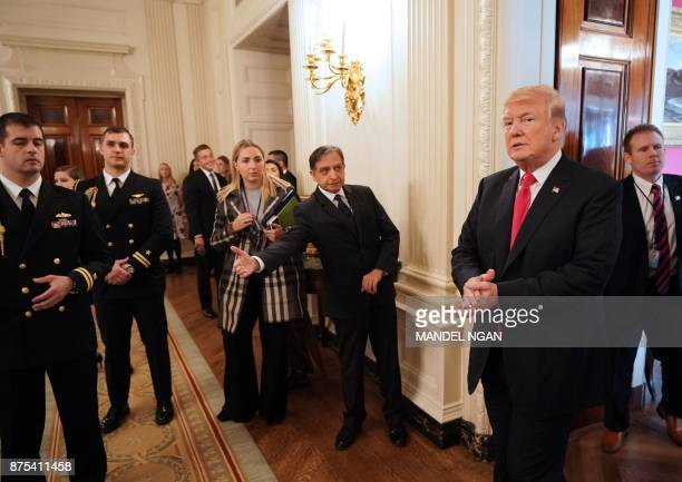 US President Donald Trump arrives in the State Dining Room during an event honoring the NCAA national championship teams on November 17 2017 in...
