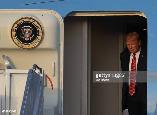 President Donald Trump arrives on Air Force One at the Palm Beach International Airport to spend part of the weekend with Japanese Prime Minister...