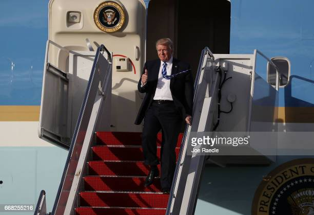 President Donald Trump arrives on Air Force One at the Palm Beach International Airport to spend Easter weekend at MaraLago resort on April 13 2017...