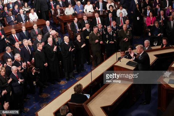 S President Donald Trump arrives to addresses a joint session of the US Congress on February 28 2017 in the House chamber of the US Capitol in...