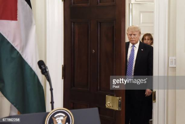 President Donald Trump arrives to give a joint statement with President Mahmoud Abbas of the Palestinian Authority in the Roosevelt Room of the White...