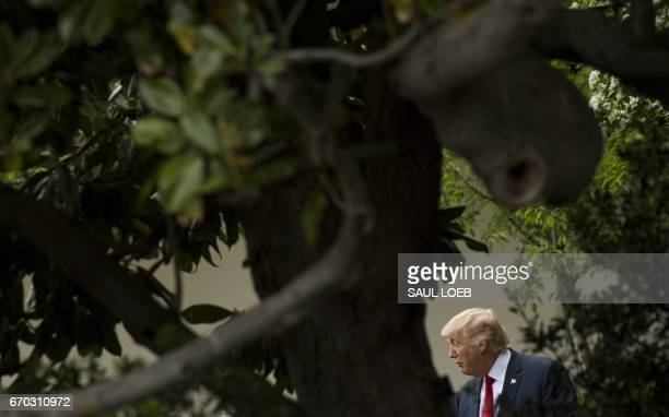 US President Donald Trump arrives to honor the New England Patriots as 2017 Super Bowl Champions on the South Lawn of the White House in Washington...