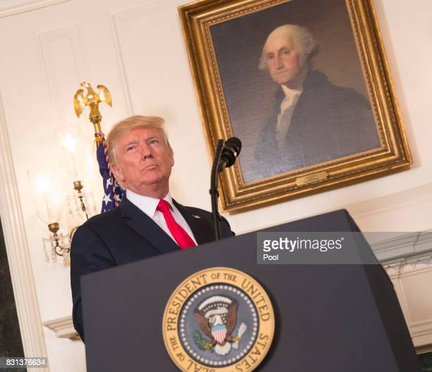 US President Donald Trump arrives to make a statement on the violence this past weekend in Charlottesville Virginia at the White House on August 14...