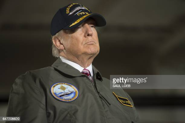 US President Donald Trump arrives to speak aboard the precommissioned USS Gerald R Ford aircraft carrier in Newport News Virginia March 2 2017 / AFP...