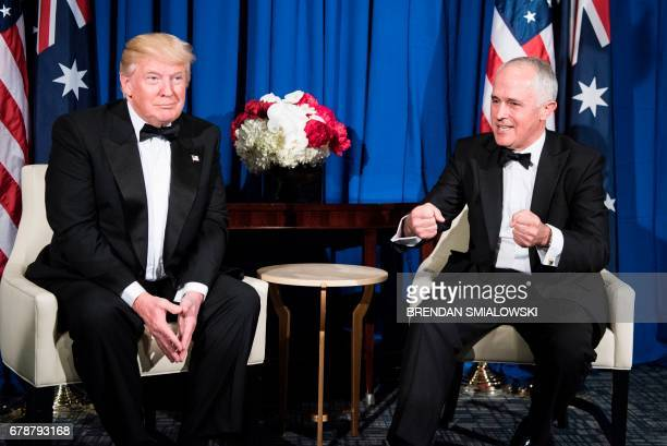 US President Donald Trump as AustralianPrime Minister Malcolm Turnbull talks about the Battle of the Coral Sea before a meeting on board the Intrepid...