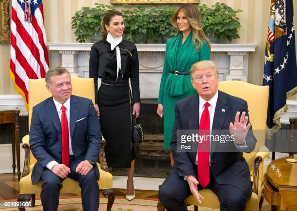 US President Donald Trump asks for the press to stay as he makes a statement on Syria as he meets King Abdullah II of Jordan in the Oval Office of...