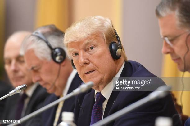 US President Donald Trump attends a bilateral meeting at the Presidential Palace in Hanoi on November 12 2017 Trump arrived in the Vietnamese capital...