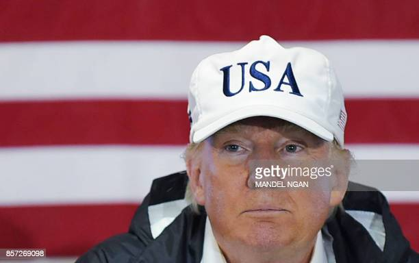 US President Donald Trump attends a briefing with senior military personnel Puerto Rico Governor Ricardo Rossello and US Virgin Islands Governor...