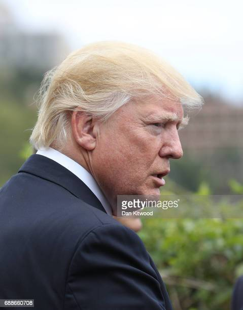 S President Donald Trump attends a flypast at the San Domenico Palace Hotel on May 26 2017 in Taormina Italy US President Donald Trump and British...