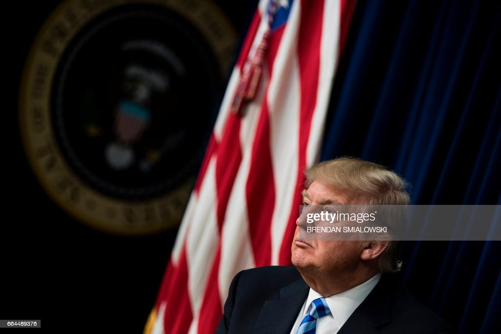 US President Donald Trump attends a forum with Chief Executive Officers on the White House Campus on April 4, 2017 in Washington, DC. / AFP PHOTO / Brendan Smialowski