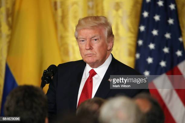 S President Donald Trump attends a joint news conference with Colombian President Juan Manuel Santos at the White House May 18 2017 in Washington DC...