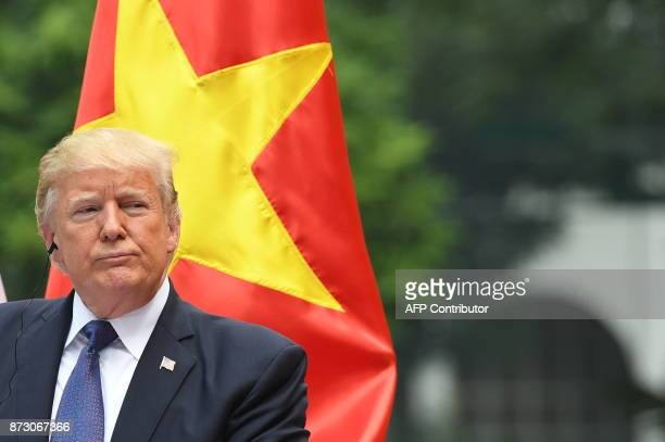 US President Donald Trump attends a joint press conference with his Vietnamese counterpart Tran Dai Quang at the Presidential Palace in Hanoi on...