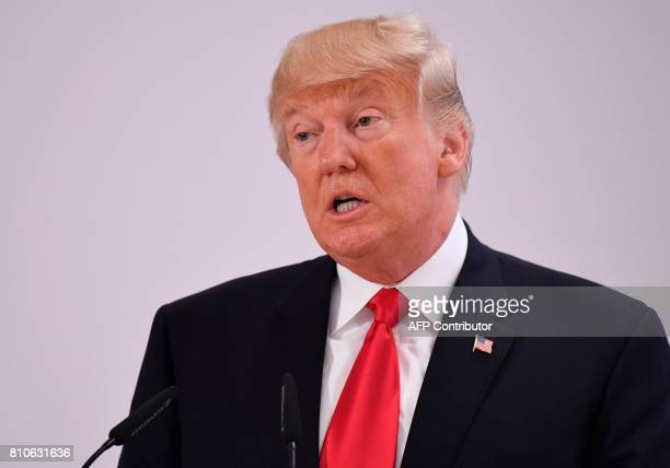 US President Donald Trump attends a panel discussion on the second day of the G20 Summit in Hamburg Germany July 8 2017 Leaders of the world's top...