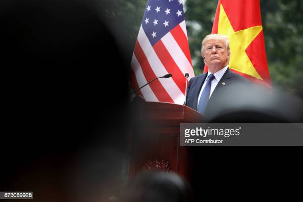 US President Donald Trump attends a press conference at the Presidential Palace in Hanoi on November 12 2017 Trump arrived in the Vietnamese capital...