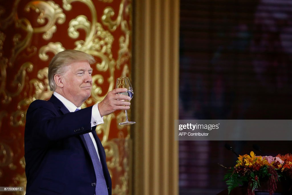 US President Donald Trump attends a state dinner hosted by China's President Xi Jinping in the Great Hall of the People in Beijing on November 9, 2017. Donald Trump urged Chinese leader Xi Jinping to work hard and act fast to help resolve the North Korean nuclear crisis during talks in Beijing Thursday, warning that 'time is quickly running out'. /