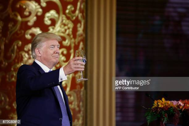 US President Donald Trump attends a state dinner hosted by China's President Xi Jinping in the Great Hall of the People in Beijing on November 9 2017...