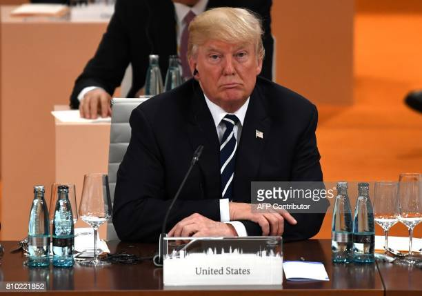 US President Donald Trump attends a working session on the first day of the G20 summit in Hamburg northern Germany on July 7 2017 Leaders of the...