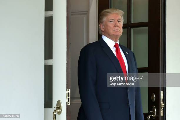 S President Donald Trump awaits the arrival of Finnish President Sauli Niinisto to the White House August 28 2017 in Washington DC The two leaders...