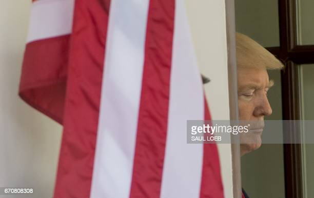 US President Donald Trump awaits the arrival of Italian Prime Minister Paolo Gentiloni for meetings at the White House in Washington DC April 20 2017...