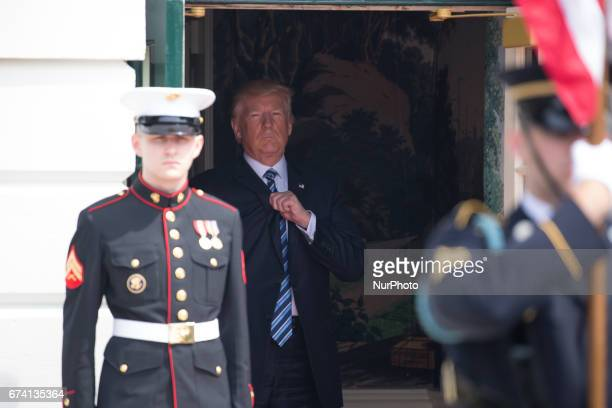 President Donald Trump awaits the arrival of President Mauricio Macri and First Lady Juliana Awada of Argentina at the South Portico of the White...