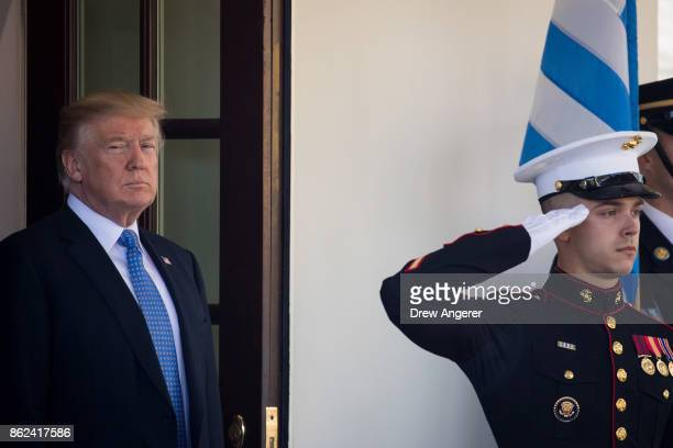 S President Donald Trump awaits the arrival of Prime Minister of Greece Alexis Tsipras to the White House October 17 2017 in Washington DC A leftwing...