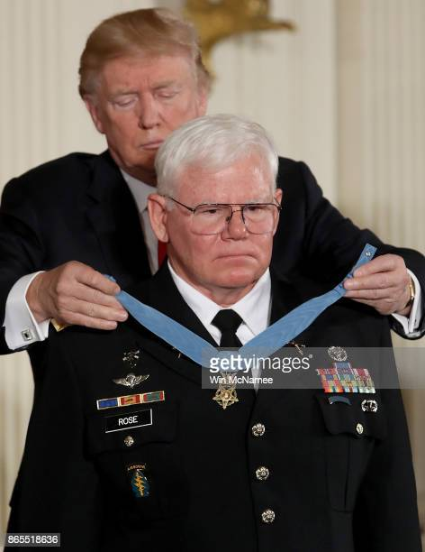S President Donald Trump awards retired US Army Capt Gary Rose of Huntsville Alabama with the Medal of Honor during a ceremony in the East Room of...