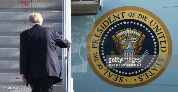 US President Donald Trump boards Air Force One prior to departing from US Yokota Air Base in Tokyo on November 7 2017 Trump's marathon Asia tour...