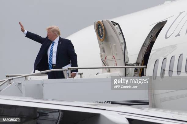 US President Donald Trump boards Air Force One prior to departure from Morristown Municipal Airport in Morristown New Jersey August 18 as he travels...