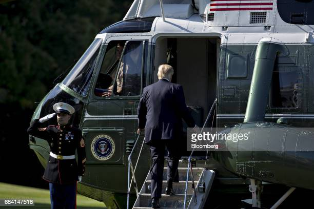US President Donald Trump boards Marine One on the South Lawn of the White House in Washington DC US on Wednesday May 17 2017 Trump is facing the...