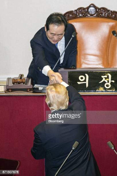 US President Donald Trump bottom shakes hands with Chung Syekyun speaker of the South Korean National Assembly at the National Assembly in Seoul...
