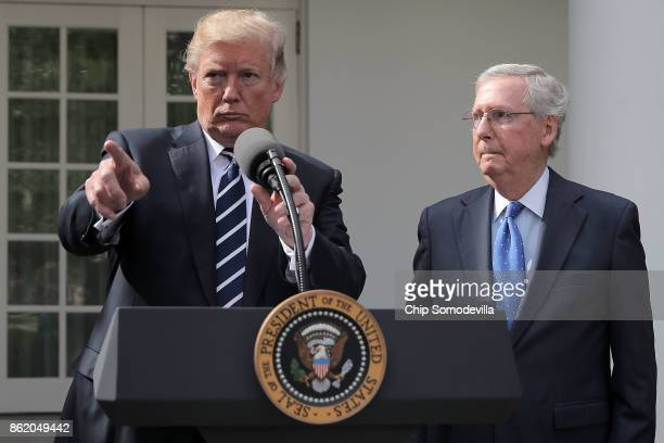 S President Donald Trump calls on reporters with Senate Majority Leader Mitch McConnell in the Rose Garden following a lunch meeting at the White...