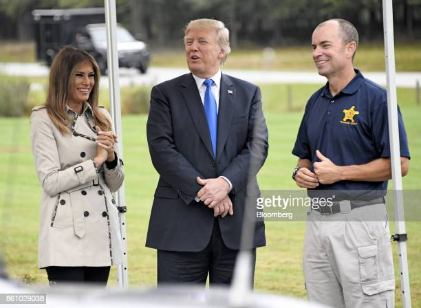US President Donald Trump center and US First Lady Melania Trump laugh with an employee while touring the US Secret Service James J Rowley Training...