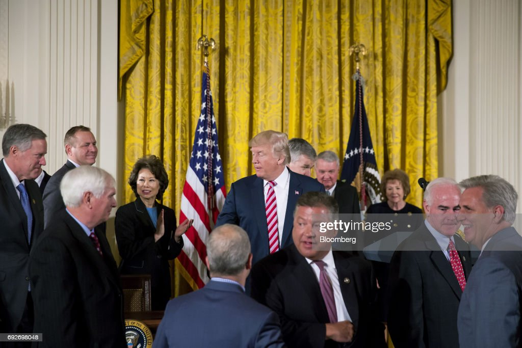 U.S. President Donald Trump, center, arrives to announce the Air Traffic Control Reform Initiative during a press conference in the East Room of the White House in Washington, D.C., U.S., on Monday, June 5, 2017. Trump on Monday unveiled his proposal to hand over control of the U.S. air-traffic control system to a non-profit corporation, calling the current system an antiquated mess that doesnt work and wastes money. Photographer: Eric Thayer/Bloomberg via Getty Images