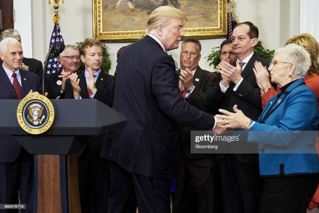 U.S. President Donald Trump, center, greets Representative Virginia Foxx, a Republican from North Carolina, right, before he signs an executive order on health care in the Roosevelt Room of the White House in Washington, D.C., U.S., on Thursday, Oct. 12, 2017. Trumpsigned an executive order Thursday designed to expand health insurance options for some Americans, in a move that may also undermine coverage for those who remain in Obamacare. Photographer: T.J. Kirkpatrick/Bloomberg via Getty Images