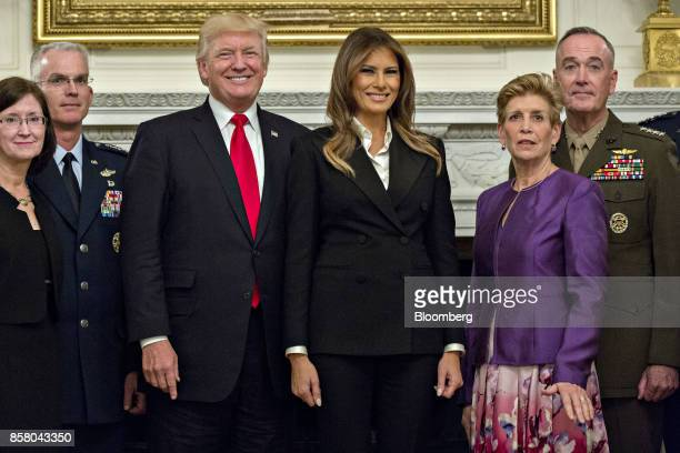 US President Donald Trump center left and US First Lady Melania Trump center right stand for an official photograph with senior military leaders and...