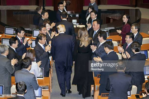 US President Donald Trump center left and US First Lady Melania Trump center right are applauded at the National Assembly in Seoul South Korea on...