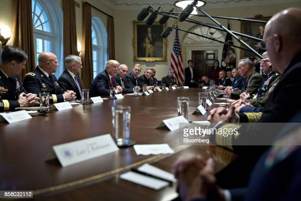 US President Donald Trump center left speaks during a briefing with senior military leaders in the Cabinet Room of the White House in Washington DC...