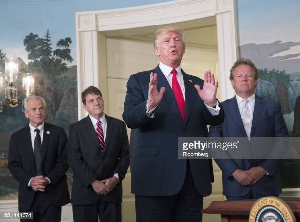 US President Donald Trump center responds to a question from a member of the media after signing a memorandum on addressing China's laws policies...