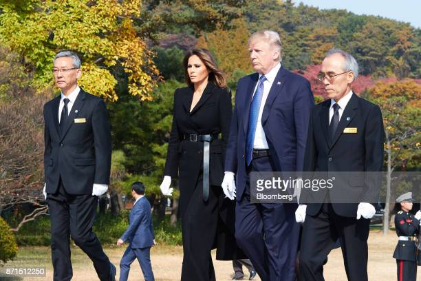 US President Donald Trump center right and US First Lady Melania Trump center left visit the National Cemetery in Seoul South Korea on Wednesday Nov...