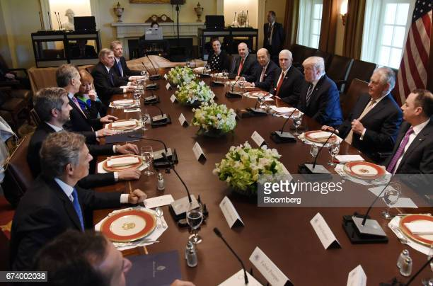 US President Donald Trump center right listens while Mauricio Macri Argentina's president center left speaks during a luncheon at the White House in...