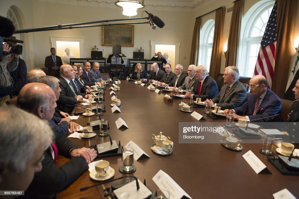 U.S. President Donald Trump, center right, speaks as Haider al-Abadi, Iraq's prime minister, center left, listens during a meeting at the White House in Washington, D.C., U.S., on Monday, March 20, 2017. Trump used a White House meeting with al-Abadi to criticize both his immediate predecessors' military strategies in the country. Photographer: Chris Kleponis/Pool via Bloomberg