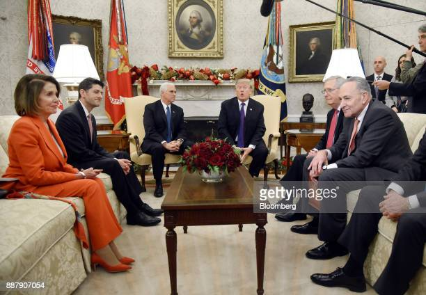 US President Donald Trump center right speaks as House Minority Leader Nancy Pelosi a Democrat from California from left US House Speaker Paul Ryan a...